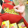 Four-year-old Velvet Schofield, of Granby, lchecks out a box of snappers while shopping withher family for fireworks on Wednesday at Black Market Fireworks on North Main Street.<br /> Globe | Laurie Sisk