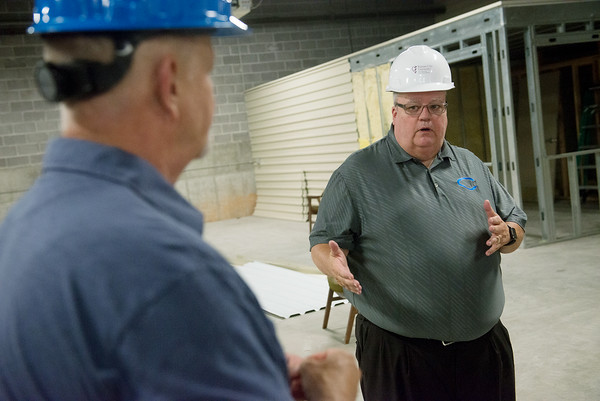 Globe/Roger Nomer<br /> Andy Wilson, AMT lead instructor at Crowder, left, and Glen Coltharp, vice president at Crowder College, talk about the new welding area at the Advanced Training and Technology Center on Wednesday.
