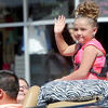 Little Miss Galena contestant ReAna Lopez waves to the crowd during the Galena Days Parade on Saturday in downtown Galena.<br /> Globe | Laurie Sisk