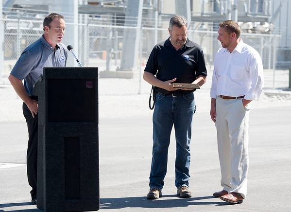 From the left: Blake Mertens, Empire vice president of Energy Supply and Delivery Operations, presents a plaque to Riverton Plant Manager Ed Easson and Director of Energy Supply Services Tim Wilson during the dedication of Empire's new power plant in Riverton on Tuesday. <br /> Globe | Laurie Sisk