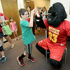 Nine-year-old Kannon Brasch gets a high five from Gus the Gorilla during Macot Day at the Joplin Public Library. Seven mascots from area sports teams and local businesses were on hand to greet children during the event.<br /> Globe | Laurie Sisk