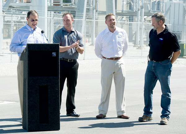 From the left: Burns and McDonnell General Manager Rick Halil, Empire Vice President of Energy Supply and Delivery Operations, Blake Mertens, Empire Riverton Plant Manager Ed Easson and Empire Director of Energy Supply Services Tim Wilson join in the dedication of Empire's new power plant in Riverton on Tuesday. <br /> Globe | Laurie Sisk