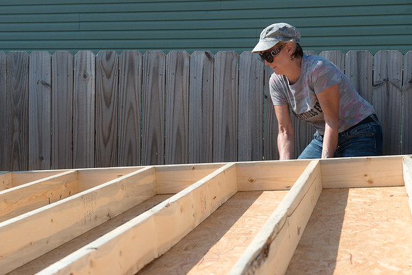 Globe/Roger Nomer<br /> Christine Gospodarski, St. Louis, volunteers at the Fuller Center for Housing build site on Kentucky on Friday morning.