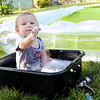 Ten-month-old Kaeden Vincent cools off in his scaled down version of a kiddie pool beside the big kids pool at his home on 17th street on Thursday afternoon. As an added bonus, Vincent also got soap bubbles to play with.<br /> Globe | Laurie Sisk