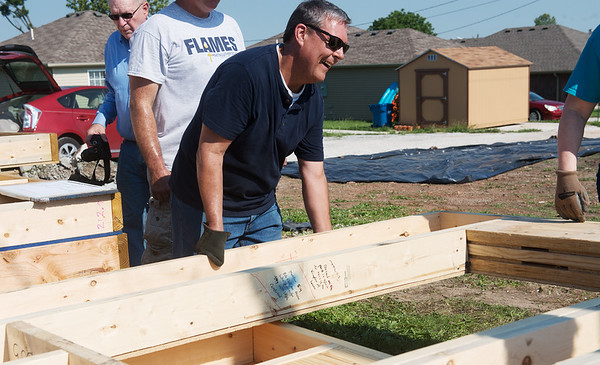 Globe/Roger Nomer<br /> Frank Fischer, St. Louis, volunteers at the Fuller Center for Housing build site on Kentucky on Friday morning.