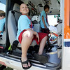 13-year-old Weston, of Joplin, smiles as he gets a close up look at a Mercy air ambulance on Tuesday at Camp Quality near Neosho. The week-long camp, which is one of 15 in the U.S.,  offers children ages 4 to 18 battling cancer a chance to be  kids again