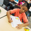 Globe/Roger Nomer<br /> Eloym Marquez, second grade, works on a project on Monday at Soaring Heights Elementary.