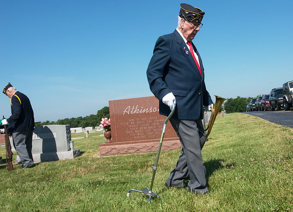 Globe/Roger Nomer<br /> Ken LaNear, the bugler for the Robert Thurman American Legion Post, leaves a funeral in Diamond on Tuesday.