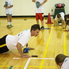 Globe/Roger Nomer<br /> Justin Mckee, a Missouri Southern junior from Neosho, leads children in push ups during Thursday's Lifetime Sports Academy at Young Gymnasium.