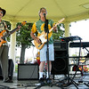 "Members of the Joplin-based band ""Catalyst"" donate their talents as they entertain guests at Nan's Band-Aid on Saturday at Schifferdecker Park. Proceeds from the event will go to help the 40 employees who lost their jobs after a fire closed the laundry section at Joplin Workshops. The event was named after the late Nancy Clarkson, longtime employee at the workshop.<br /> Globe 