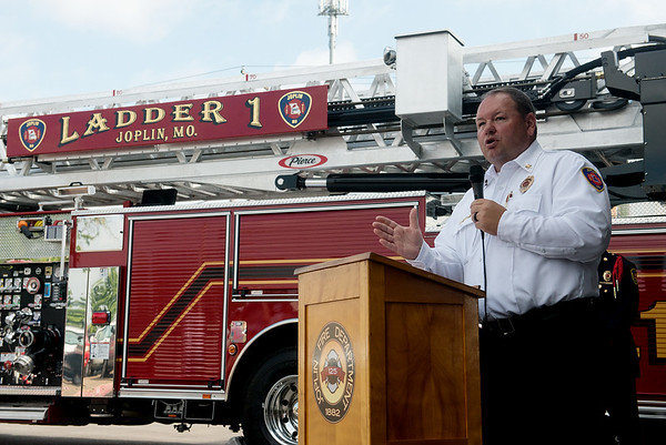 Globe/Roger Nomer<br /> Fire Chief Jim Furgerson talks about the department's new fire truck on Monday at the Main Street fire station.