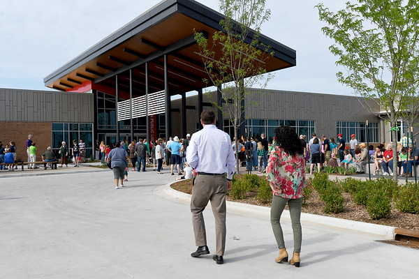 Hundreds of curious guests and longtime library patrons flock to the opening of the new Joplin Public Library on Saturday. An estimated 400 people attended the ribbon cutting ceremonies for the library at 20th and Connecticut streets.<br /> Globe | Laurie Sisk