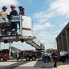 Globe/Roger Nomer<br /> Levi Sack, driver engineer, takes Joplin Councilmembers Jim West and Melodee Colbert-Kean for a ride in the new bucket truck on Monday.