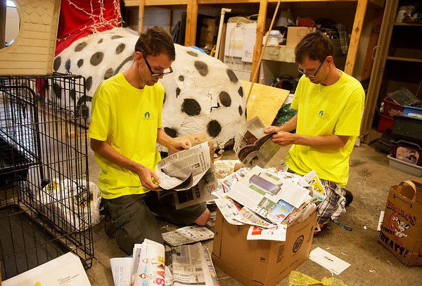 Globe/Roger Nomer<br /> Brothers Dale, left, and Carl Grissom sort papers on Friday as they volunteer at the Joplin Humane Society. The twins are among those who will benefit from a concert beginning at 2 p.m. on Saturday in Schifferdecker Park. They were left unemployed by a fire that destroyed the Joplin Workshop's laundry facility.