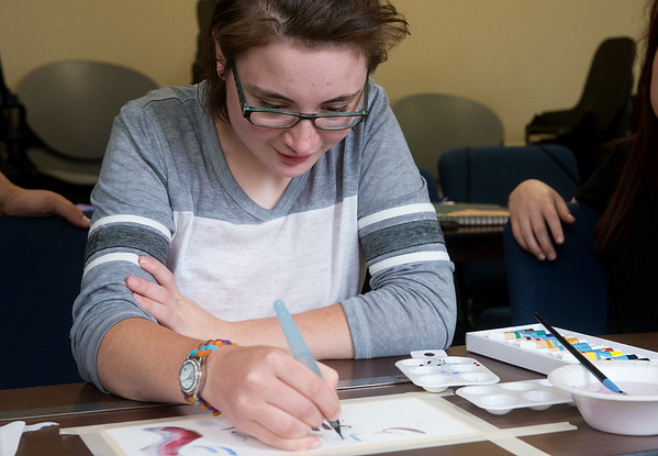 Globe/Roger Nomer<br /> Anna Baker, 16, Carthage, works with watercolors on Tuesday at the Creative Art Academy at Ozark Christian College. The week-long camp has drawn 101 students from 13 states to campus to learn in fields such as animation, improv and techinical staging.