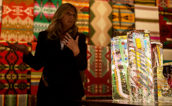 Globe/Roger Nomer<br /> Britt Cornett, head of exhibitions at Chihuly Studios, talks about Native American influences in Chihuly's work, including in his Cylinders series.