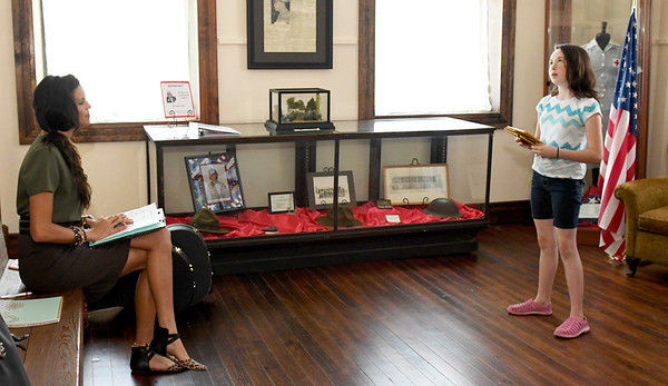 "Director Natasha O'Brien-Davis listens as Leanna Schlessman, 10, auditions for the role in ""Snake County Stories"" on Thursday night at the McDonald County Historic Courthouse. Organizers hope the oral history, which has been presented in the past, will become an annual event.<br /> Globe 