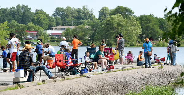Hundreds flock to Kellogg Lake in Carthage on Saturday for Kid's Fishing Day. The event featured information booths, activities, food and fishing - all free of charge to guests.<br /> Globe | Laurie Sisk