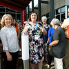 Joplin Public Library Director Jacque Gae, center, announces the opening of the new Joplin Public Library on Saturday. An estimated 400 people attended the ribbon cutting ceremonies for the library at 20th and Connecticut streets.<br /> Globe | Laurie Sisk