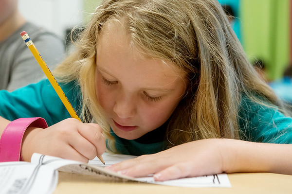 Globe/Roger Nomer<br /> Cooper Vainio, second grade, works on an assignment on Monday at Soaring Heights Elementary.