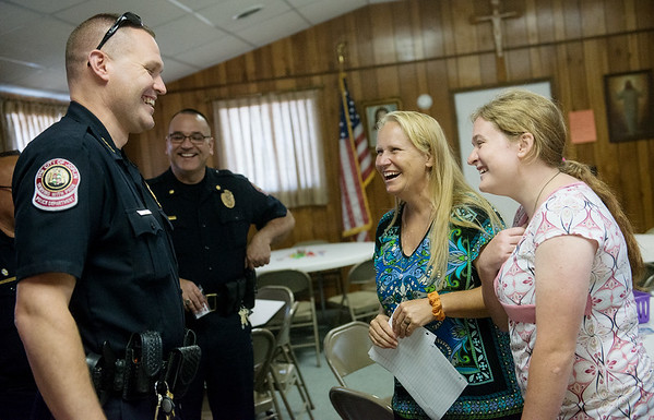 Globe/Roger Nomer<br /> Joplin Police Chief Matt Stewart, left, and Assistant Chief Sloan Rowland talk with Christy LaTurner House and Mali House on Friday during the luncheon in Galena at St. Patrick's Hall.