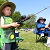 From the left: Three-year-old Jeremy Noller keeps his eyes on the prize as big brother Derak Noller looks on during Kid's Fishing Day on Saturday at Kellogg Lake in Carthage. The event featured information booths, activities, food and fishing - all free of charge to guests.<br /> Globe | Laurie Sisk