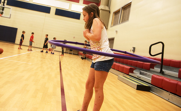Globe/Roger Nomer<br /> Paicli Moore, third grade, plays with a hula hoop on Monday at Soaring Heights Elementary.