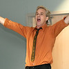 Comedian and cancer survivor Scott Burton entertains guests at Canver Survivor Day on Thursday at Mercy Hospital. Burton, who is a 25-year survivor of osteosarcoma, was one of several speakers at the event.<br /> Globe | Laurie Sisk