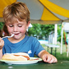 Globe/Roger Nomer<br /> Dannah Cassatt, 4, Webb City, eats on Tuesday at the Webb City Farmers Market.