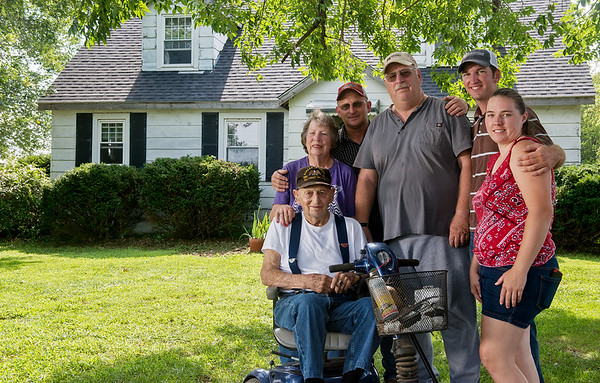 Globe/Roger Nomer<br /> Mike Wilkerson, center, is reunited with his family (from left) parents Max and Delores Wilkerson, brother Scott and his son Clint with wife Sadie Wilkerson, on Tuesday at his farm near Avila.