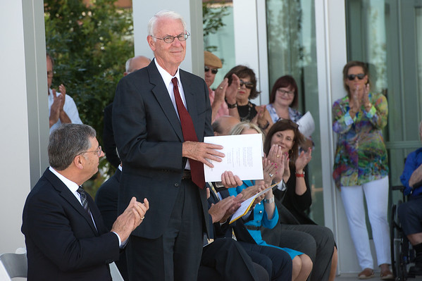 Globe/Roger Nomer<br /> Larry McIntire is recognized for his efforts during the ribbon cutting on Tuesday at the Joplin campus of the Kansas City University of Medicine and Biosciences.