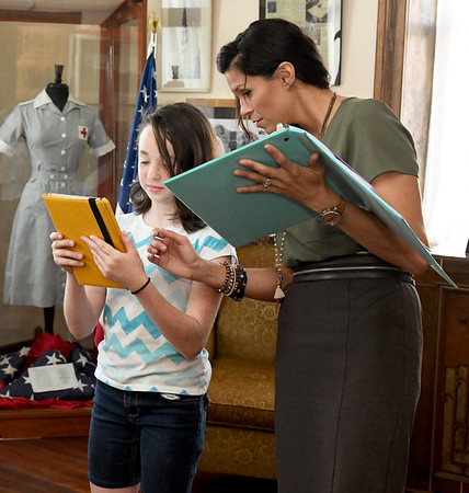 "Director Natasha O'Brien-Davis works with prospective cast member Leanna Schlessman, 10, during auditions for ""Snake County Stories"" on Thursday night at the McDonald County Historic Courthouse. Organizers hope the oral history, which has been presented in the past, will become an annual event.<br /> Globe 
