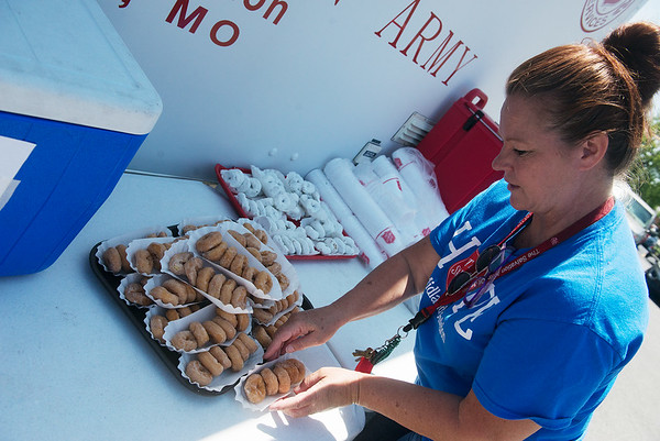 Globe/Roger Nomer<br /> Debra Gaskill, emergency social services case manager for the Joplin Salvation Army, stock doughnuts on Friday as the Salvation Army Store for Salvation Army Doughnut Day. The day commemorates the Salvation Army Doughnut Girls, who served coffee and doughnuts to soldiers on the front lines during WWI and WWII.