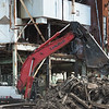 Globe/Roger Nomer<br /> Workers prepare a site for demolition at the Riverton Empire plant on Thursday.