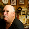 Globe/Roger Nomer<br /> Surrounded by family photos, Mike Wilkerson talks about his time in a mental hospital during an interview on Friday at his home in Avila.
