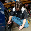 Globe/Roger Nomer<br /> Greg Baldes, lead tire tech at Reeves Tire and Automotive, checks tire pressure on Thursday at the store. One way to helps prevent air pollution is to make sure tires are inflated to the correct levels.