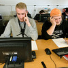 From the left: Sarcoxie seniors-to-be Kadin Bass and Chase Smith study Algebra II and Geometry, respectively during summer school on Friday at Sarcoxie High School.<br /> Globe | Laurie Sisk
