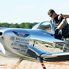 "U.S. Air Force Major Joe ""Rifle"" Shetterly, of Kansas City, steps into his RV-8 sport airplane before performing for spectators on Saturday during the Celebrate Neosho Air Show at Neosho's Hugh Robinson Airport. Shetterly has served two tours of duty as a pilot in Afghanistan and is a former A-10 ndemo pilot. The day-long event featured carnival rides, vendors, helicopter rides, tandem sky diving and more. The excitement was capped off by a large airshow and fireworks display. As many as 5,000 spectators were expected to attend the fourth annual event.<br /> Globe 