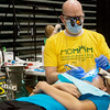 Globe/Roger Nomer<br /> Erick Jansson, Jefferson City, works on McKindsey Tunnell, 14, Neosho, on Friday at the Missouri Mission of Mercy clinic at Missouri Southern.