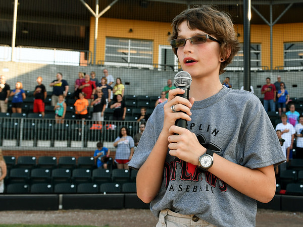 "Eleven-year-old Paul Pommier, of Baxter Springs, entertains the crowd with the ""Star Spangled Banner"" on Friday night before the Outlaws game aginst Chilicothe at Joe Becker Stadium.<br /> Globe 