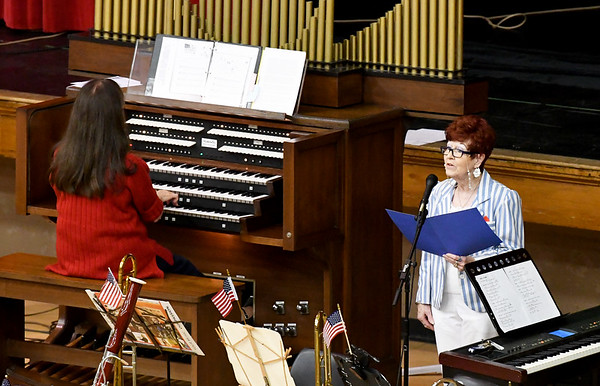"From the left: Organist Marcia Ball accompanies Kay Vreeland's reading of her original composition, ""She Waves in Victory,"" during the Joplin Area Organists Association's ""Rally 'round the Flag"" free concert on Saturday afternoon at Memorial Hall. The event combined the talents of the organists with the Heartland Concert Band for an afternoon of patriotic favorites.<br /> Globe 