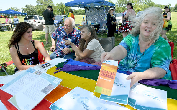 From the left: Julie Baer, Steve Weldon, Gerrie Johnston and Janet Johnson hand out information on Unity Church during  Joplin Pride Festival 2017 on Saturday at Landreth Park. A large crowd gathered for the free event, which featured food, entertainment, crafts and numerous booths promoting various social issues.<br /> Globe | LAurie Sisk