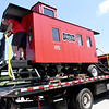 From the left: Webb City High School auto body instructor Darin Hostetter and Tyler Harris, of Cardinal towing, secure a caboose for transport to King Jack Park on Thursday afternoon at WCHS. About 20 WCHS auto body students worked on the display caboose since Dec., 2016.<br /> Globe | Laurie Sisk