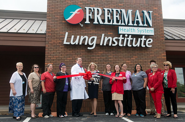 Globe/Roger Nomer<br /> Philip Slocum, Freeman pulmonologist, and Paula Baker, Freeman president and CEO, cut the ribbon on the new Freeman Lung Institute on Tuesday.