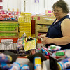 Globe/Roger Nomer<br /> Alice Grodi, Joplin, shops for fireworks on Monday at Central City Fireworks.
