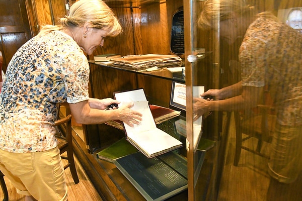 Tamara Sperry looks through scrapbooks in a display case at the Downtown YMCA on Wednesday afternoon at a reception ahead of the closing of the location. Sperry has been a member of the Downtown YMCA since 1989.<br /> Globe | Laurie Sisk