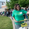 Globe/Roger Nomer<br /> Jillian Goodwin, Franklin, Kan., passes out sandwiches to people waiting in line on Friday at the Missouri Mission of Mercy at Missouri Southern.