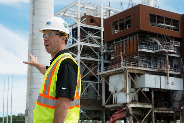 Globe/Roger Nomer<br /> Blake Mertens, vice president of operations for electric for Empire District, talks about demolition of the Riverton plant's tower and boiler building during a media tour on Thursday.