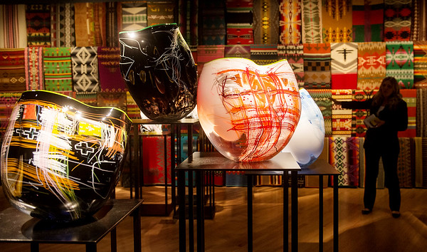 Globe/Roger Nomer<br /> Britt Cornett, head of exhibitions at Chihuly Studios, talks about Native American influence on Chihuly's Baskets series.