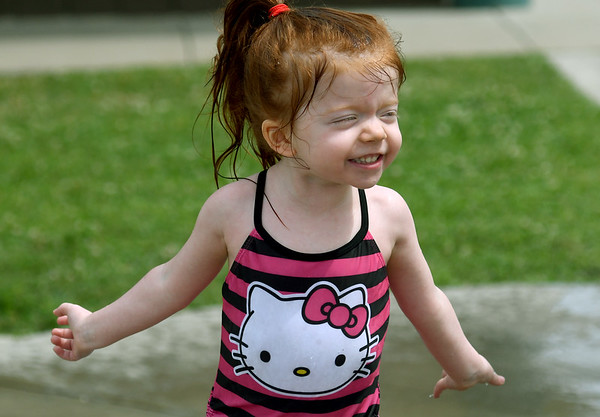 Three-year-old Destiny Hawkins squeals with delight as she plays in the Parr Hill children's spray park on Tuesday.<br /> Globe | Laurie Sisk
